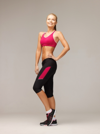 woman muscle: picture of beautiful athletic woman in sportswear Stock Photo