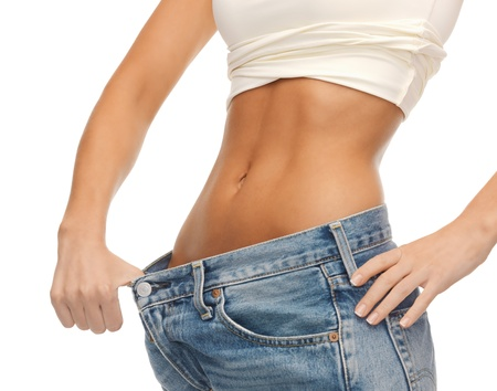 six pack abs: close up of woman showing big pants