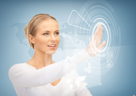 picture of attractive businesswoman touching virtual screen photo