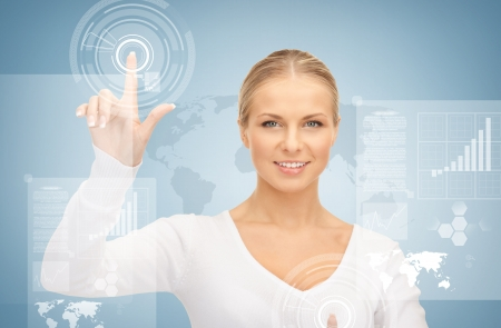 telecommute: picture of attractive businesswoman touching virtual screen