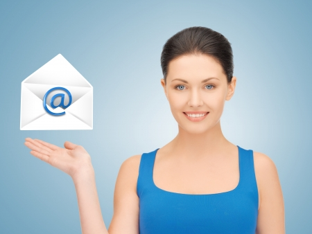 picture of smiling woman showing virtual envelope Stock Photo - 19347222
