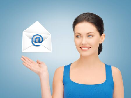 picture of smiling woman showing virtual envelope Stock Photo - 19347223