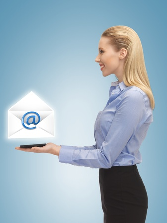 picture of smiling woman showing virtual envelope Stock Photo - 19347128