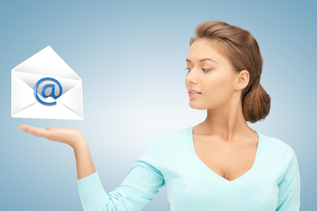 picture of young woman showing virtual envelope photo