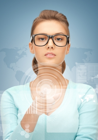 high tech world: picture of attractive businesswoman pointing at virtual screen