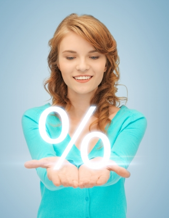 picture of girl showing sign of percent in her hand Stock Photo - 19347250