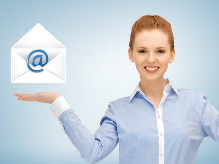 picture of smiling woman showing virtual envelope Stock Photo - 19347232