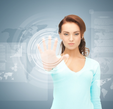 picture of attractive businesswoman touching virtual screen Stock Photo - 19347228