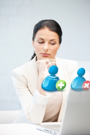 businesswoman looking at laptop with contact icon Stock Photo - 19347256