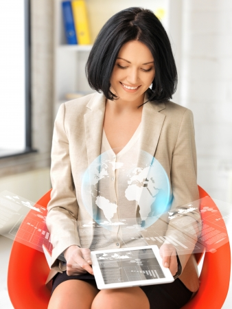 picture of happy woman with tablet pc showing virtual screen photo