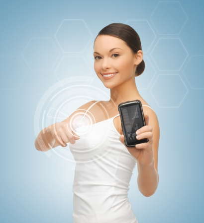 woman showing smartphone with app and pressing virtual button photo