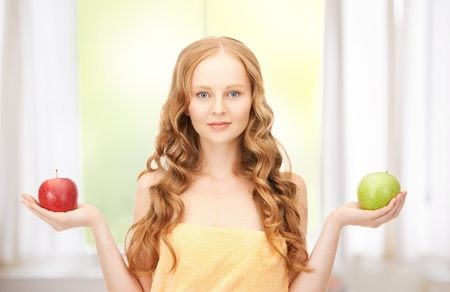 picture of young beautiful woman with green and red apples Stock Photo - 19347195