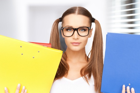 bright picture of beautiful woman with folders Stock Photo - 19347265