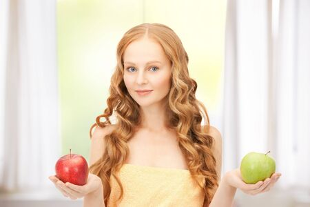 picture of young beautiful woman with green and red apples Stock Photo - 19347211
