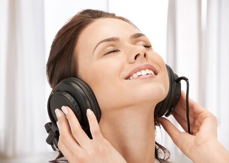picture of happy teenage girl in big headphones photo