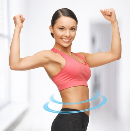 slender: picture of beautiful sporty woman flexing her biceps Stock Photo