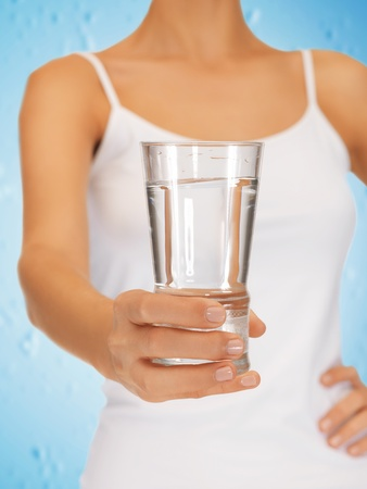 closeup picture of woman hands holding glass of water Stock Photo - 19347254