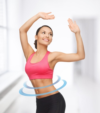 beautiful sporty woman in aerobic or dance movement