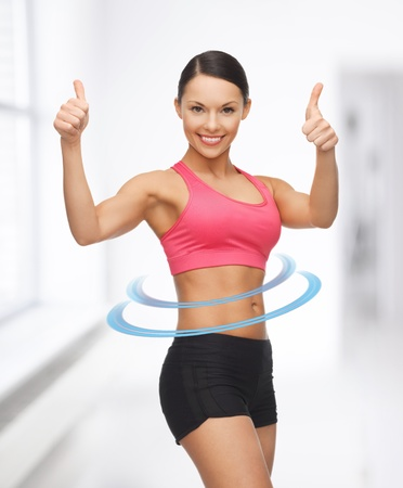 athletic wear: picture of beautiful sporty woman showing thumbs up