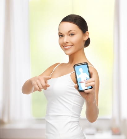 trainer device: beautiful sporty woman showing smartphone with app