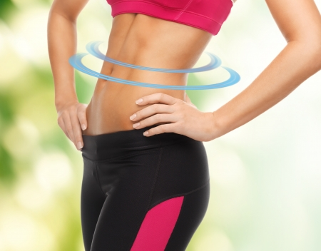 trained: close up picture of woman trained abs Stock Photo