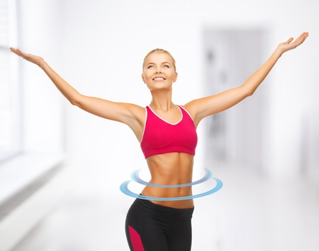 free weight: beautiful happy sportswoman with raised up hands