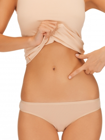 close up of woman pointing at her abs Stock Photo - 19347301