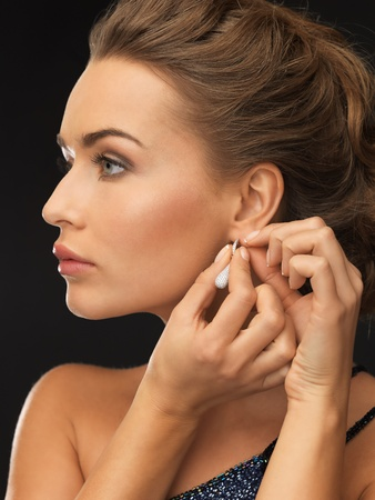 close up of beautiful woman wearing shiny diamond earrings Stock Photo - 19347298