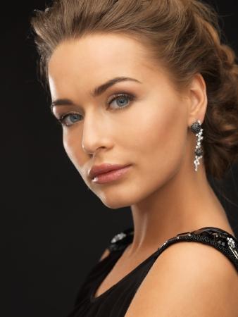 beautiful woman in evening dress wearing diamond earrings Stock Photo - 19347188