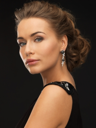 beautiful woman in evening dress wearing diamond earrings Stock Photo - 19347292