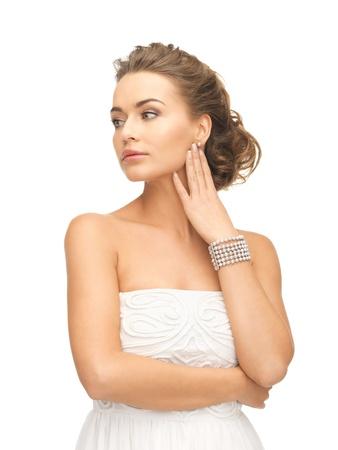 bangle: beautiful woman wearing pearl earrings and bracelet Stock Photo