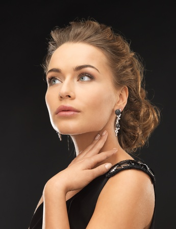club dress: beautiful woman in evening dress wearing diamond earrings