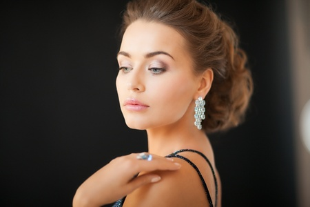 beautiful woman in evening dress wearing diamond earrings Stock Photo - 19347229