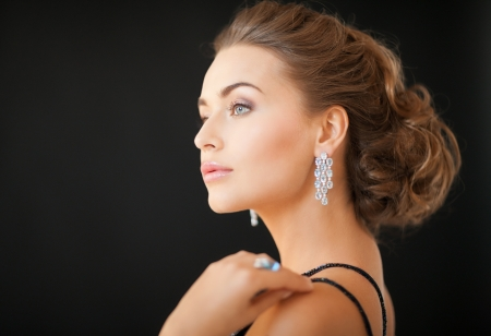 beautiful woman in evening dress wearing diamond earrings Stock Photo - 19347267