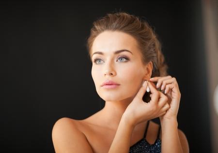 beautiful woman in evening dress wearing diamond earrings Stock Photo - 19347252