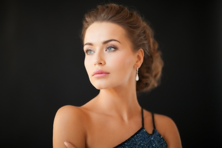 beautiful woman in evening dress wearing diamond earrings Stock Photo - 19347286