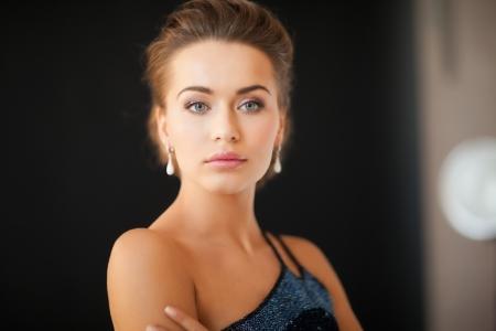 beautiful woman in evening dress wearing diamond earrings Stock Photo - 19347287