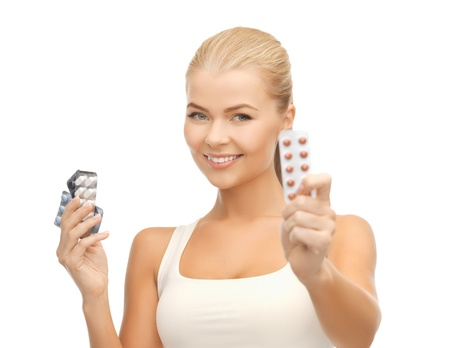 contraception: picture of young woman with variety of pills