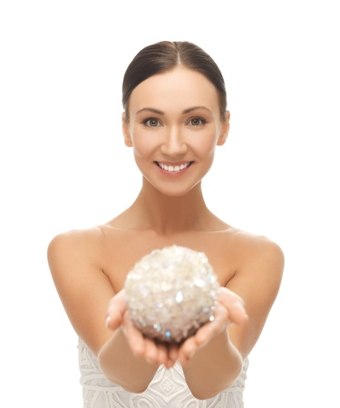 picture of beautiful woman holding sparkling ball photo