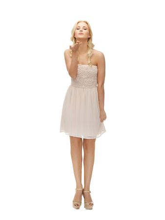 picture of young woman in white dress on high heels  Stock Photo
