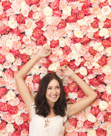 face of beautiful woman and background full of roses Stock Photo - 19347304