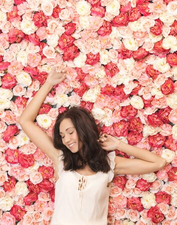 face of beautiful woman and background full of roses photo