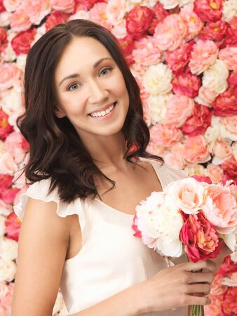 portrait of beautiful woman with background full of roses Stock Photo - 19347258