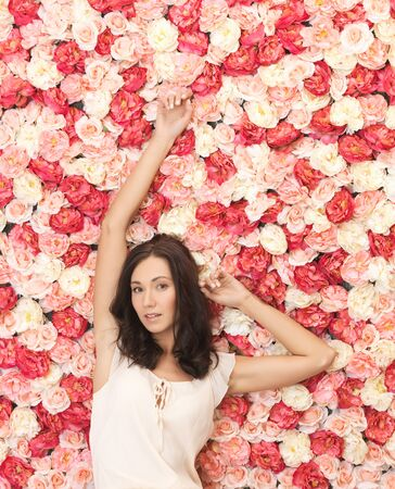 beautiful and young woman with background full of roses Stock Photo - 19347296