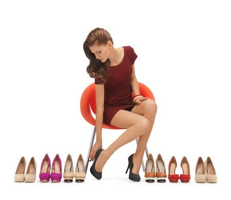trying: picture of sitting woman trying on high heeled shoes Stock Photo