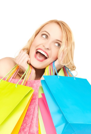 picture of crazy woman with shopping bags   photo