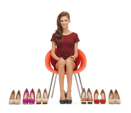 young woman sitting: picture of sitting woman with high heeled shoes Stock Photo