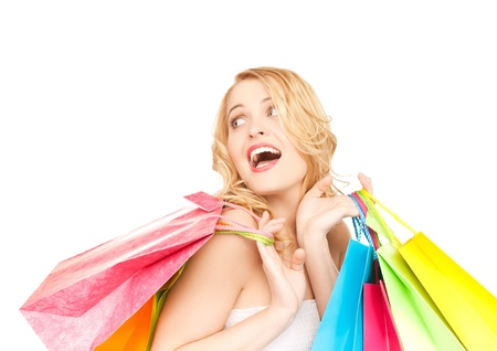 closeup on bags: picture of happy woman with shopping bags