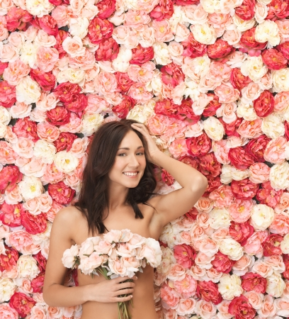 beautiful woman and background full of roses Stock Photo - 19347291