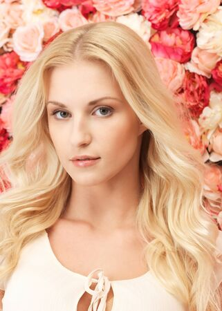 beautiful and young woman with  background full of roses Stock Photo - 19347255